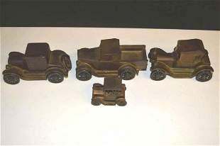 Four Pressed Steel Trucks