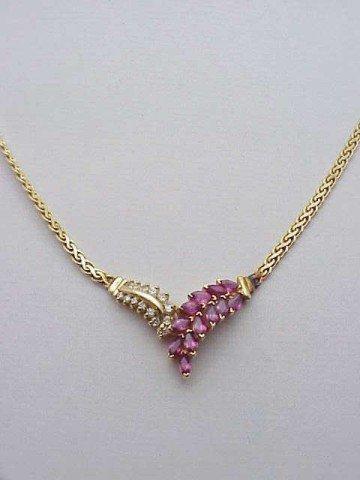9: Lady's 14kyg diamond/ruby necklace