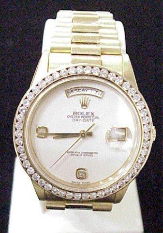 12: Gent's 18kyg Rolex President/diamonds