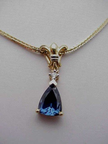 3: Lady's 14kyg blue sapphire and diamond necklace  wei