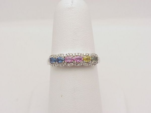 22: Lady's 14k white gold colored sapphire ring  contai