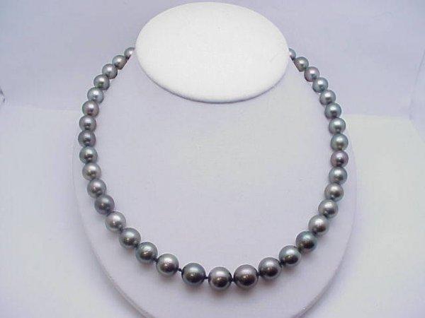 "21: 20"" strand black Tahitian pearls"