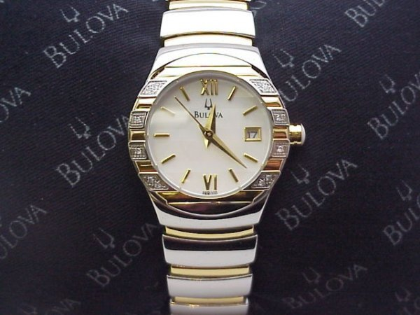 252: Lady's 2 tone Bulova diamond watch mop