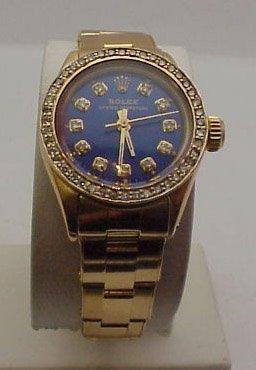 6: Lady's 18kyg Rolex Oyster watch diamonds