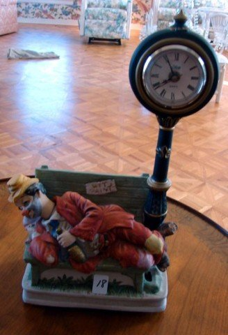 18: Clown on a Bench with a Bottle Figural Clock