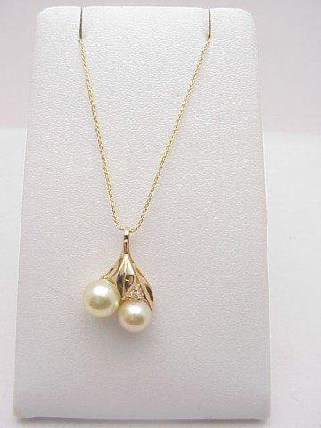 15: Lady's 14kyg pearl/diamond pendant