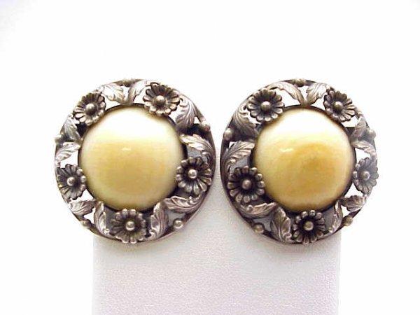 20: Designer earrings in sterling by N.E. From