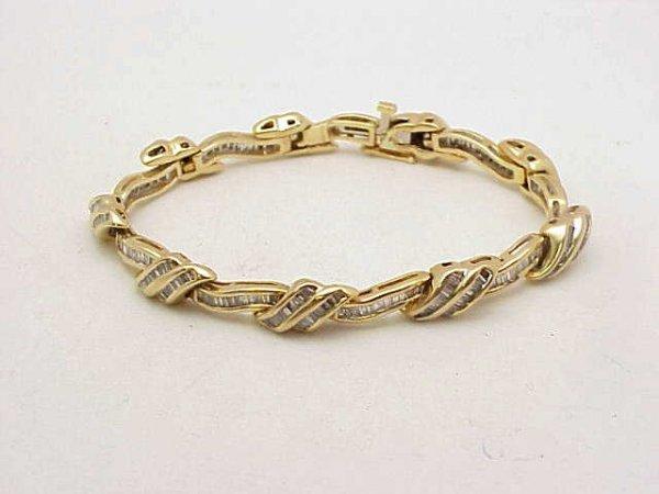 21: Lady's 14kyg baguette diamond bracelet 4ct