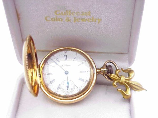 11: Lady's 14kyg pocket watch with lapel pin