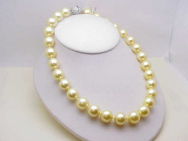 6: Lady's strand 14mm syn. pearls with cz clasp