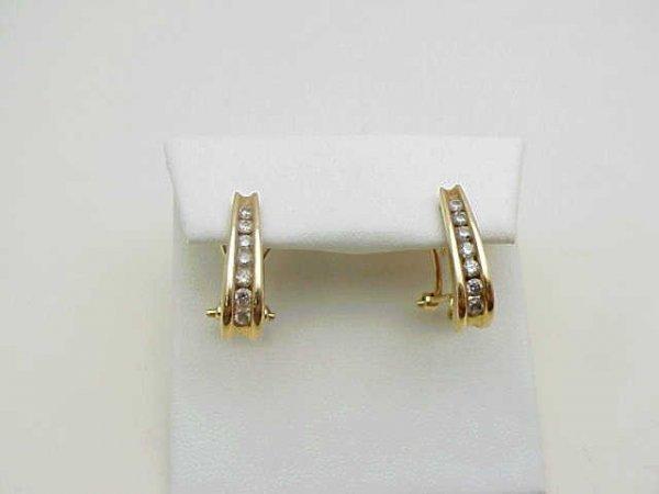 9: lady's 14kyg diamond earrings