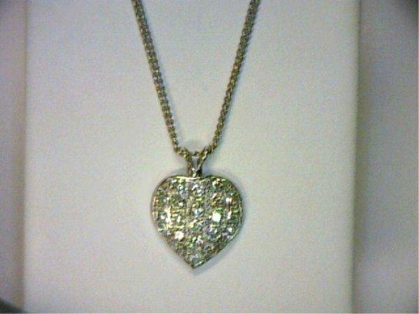 16: Vintage 14kwg diamond heart pendant