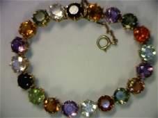 337: Lady's 18kyg multi colored stone bracelet