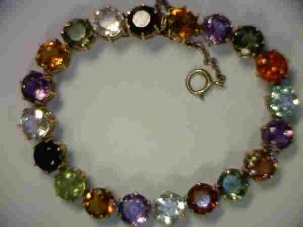 Lady's 18kyg multi colored stone bracelet