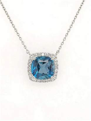 18kt white gold topaz and diamond pendant by Doves
