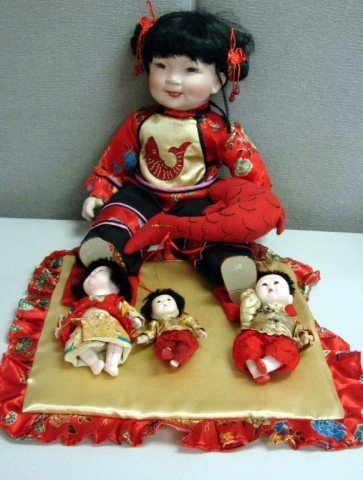 4: Large Chinese Porcelain Doll & 5 Small Dolls