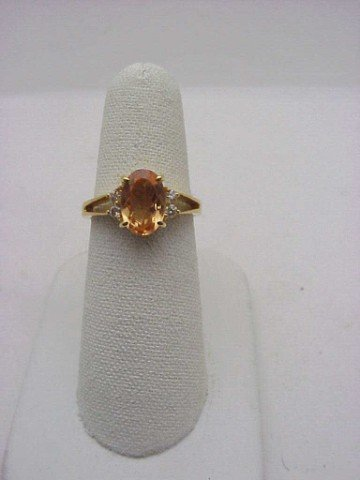 21: Lady's 18kyg imperial topaz/diamond ring