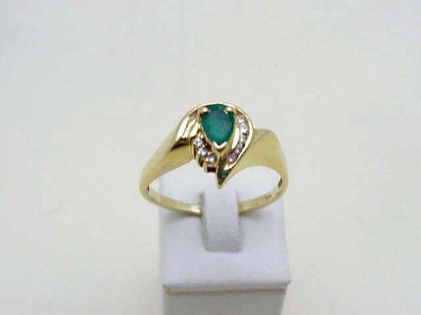 8: Lady's 14kyg emerald/diamond ring