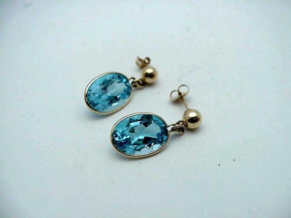 11: Lady's 14kyg Blue Topaz dangle earrings