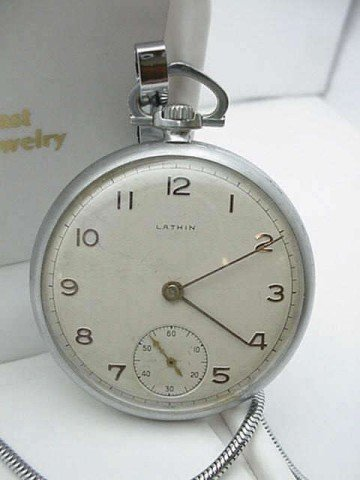12: Vintage Lathin pocket watch with fob
