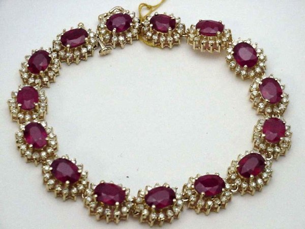 74A: Lady's 14kyg ruby/dia. bracelet 28ctw