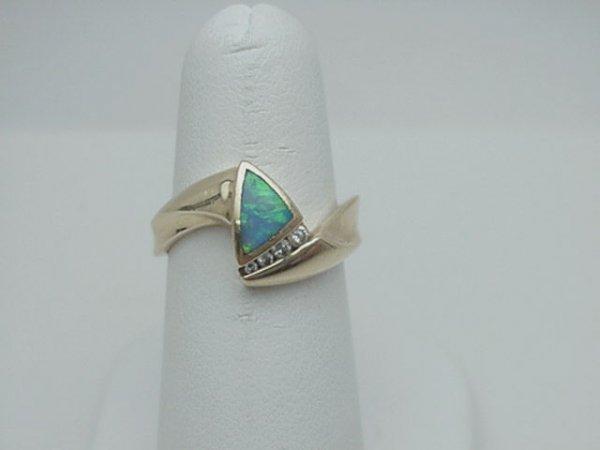 10: Lady's 14kyg opal/diamond ring