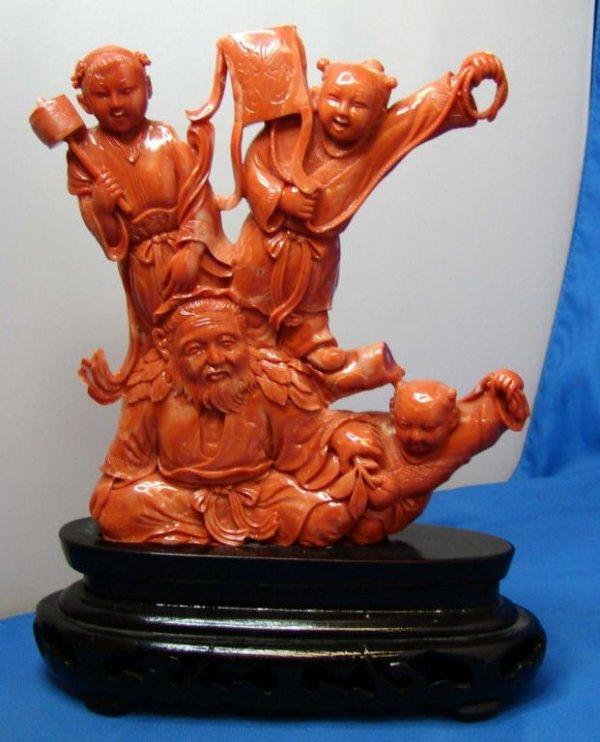 96: Orange Coral Ornately Carved Chinese Figurine