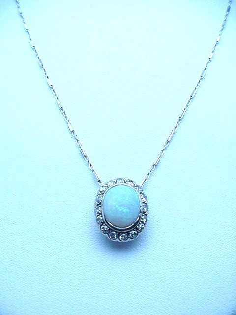 6: Lady's 14kwg opal/diamond pendant