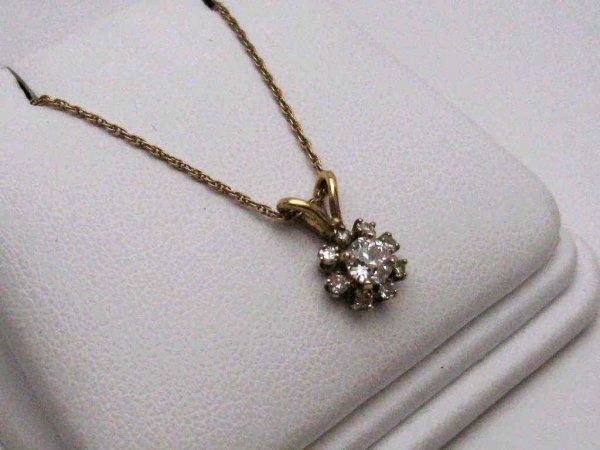 12A: Lady's 14kyg diamond pendant .40ctw