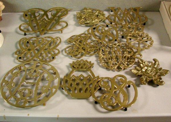 9: Lot of 13 Brass Trivets