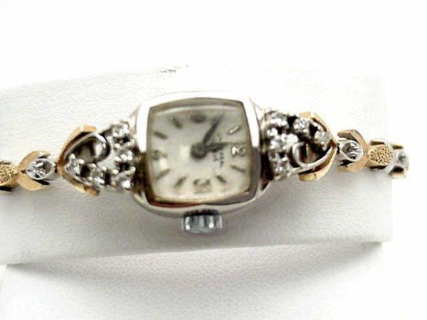 12: Lady's 14k 2tone Geneve watch