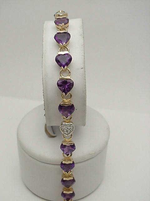15: Lady's 14kyg amethyst heart bracelet