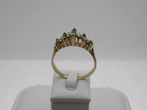 6: Lady's 14kyg emerald and diamond ring