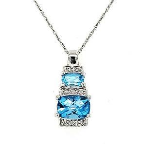 14kt white gold blue topaz and diamond pendant