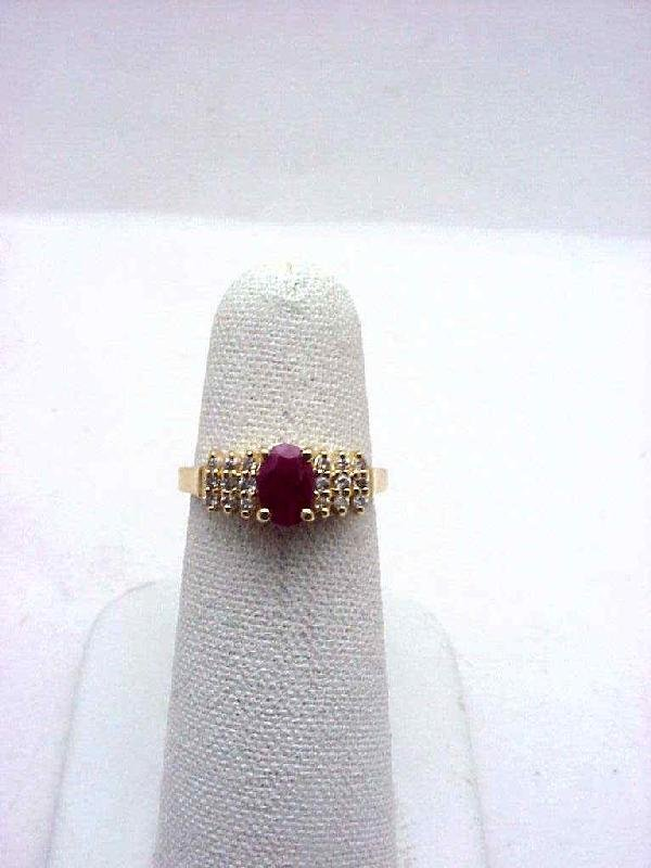 4: Lady's 14kyg ruby/diamond ring