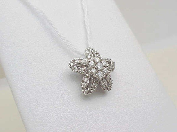 11: Lady's 14kwg diamond floral pendant