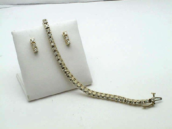 16: 14kyg diamond bracelel & earrings 2.30ctw