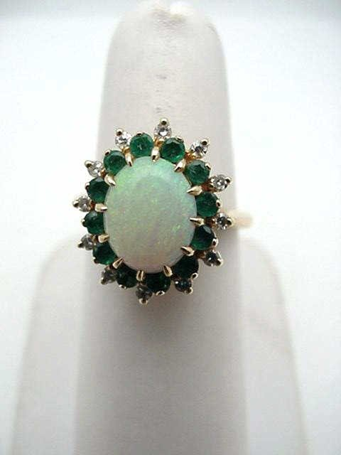 20: 14kyg opal & diamond ring w/emeralds