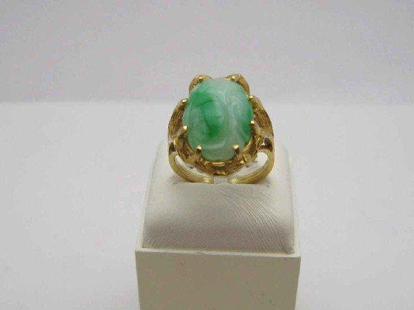 16: 14kyg carved floral jade ring