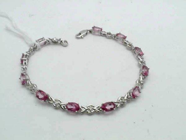 10: Lady's 14kwg pink topaz/diamond bracelet
