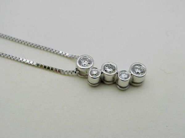 12: Lady's 14kwg diamond pendant
