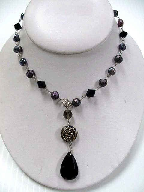 7A: Pearl necklace Swarovski Givenchy