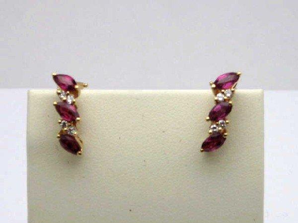 8A: 14kyg ruby& diamond earrings