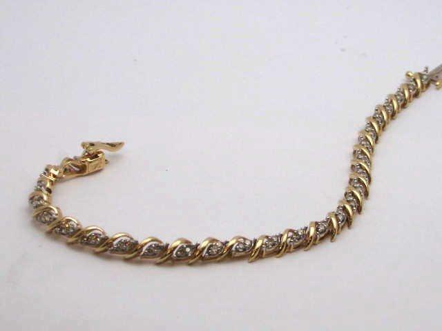 5: 14kyg diamond bracelet .85ctw
