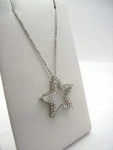 11: 14kwg diamond star pendant .75ctw