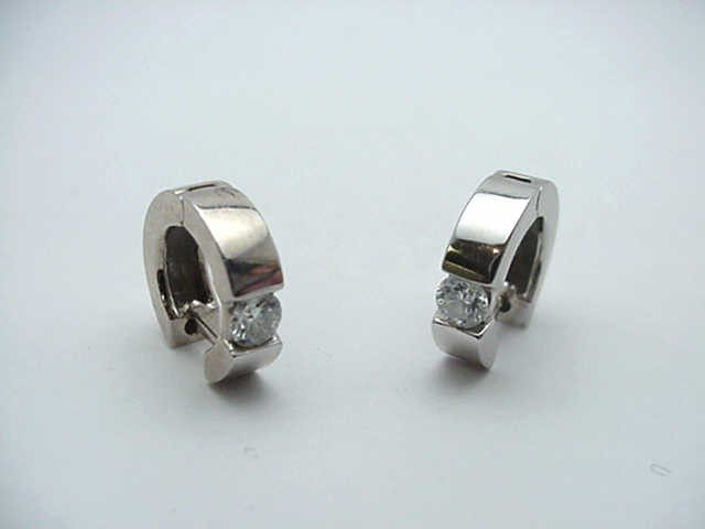 "12: Lady's 14kwg diamond ""Huggie"" earrings"