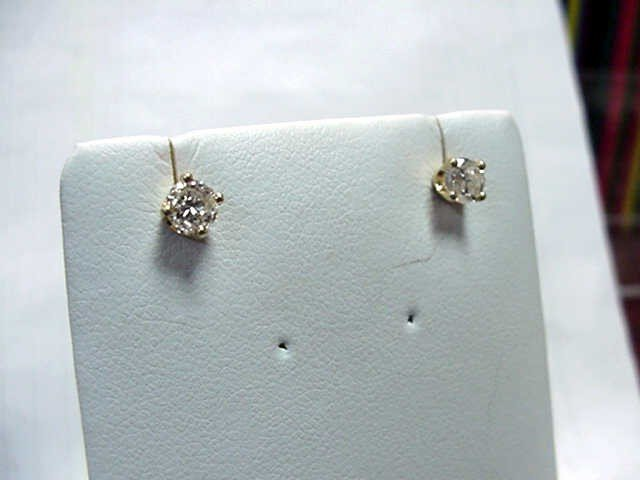 12: .50ctw diamond stud earrings