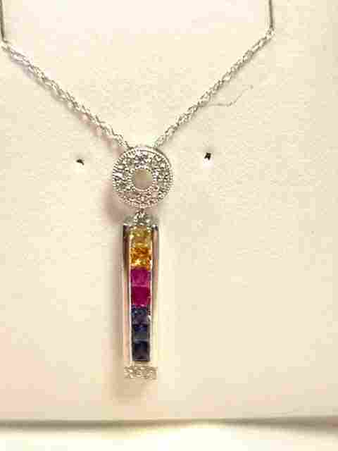 10: Lady's 14kwg sapphire & diamond pendant