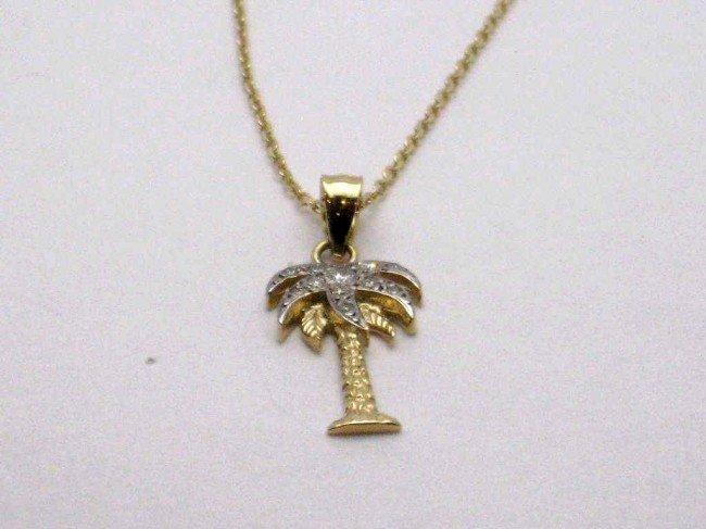 2A: 14kyg diamond palm tree necklace