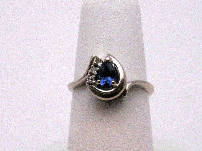 6: 14kwg blue sapphire & diamond ring
